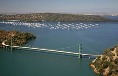 The Green Bridge passes over full water levels near Bidwell Marina on July 20, 2011, in Oroville, California, and much lower levels on Aug. 19, 2014. Credit: Getty Images