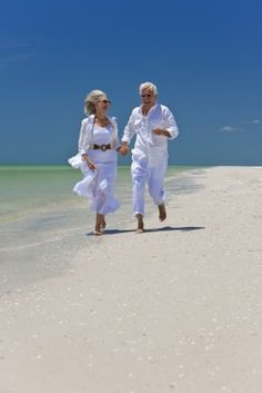 Photo about Happy senior man and woman couple running, laughing and holding hands on a deserted tropical beach with bright clear blue sky. Image of aging, active, cool - 14436962 Couples Âgés, Vieux Couples, Older Couples, Couples In Love, Photo Summer, Couple Running, Growing Old Together, Couples Walking, Aging Parents