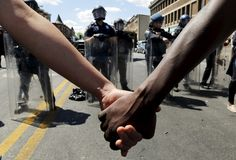 African American Riots | Holding hands in front of a police line in Baltimore. (Reuters//Jim ...