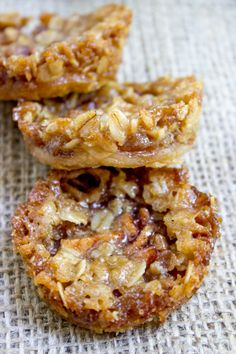 Apple Crisp Cookies with a pie crust bottom, sweetened spiced apples and a brown sugar and oat crust. All the fun of crisps and pies with just enough filling to make you feel like you're being healthy!