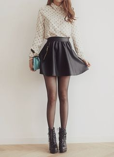 Shop this look on Lookastic:  https://lookastic.com/women/looks/dress-shirt-skater-skirt-lace-up-ankle-boots-clutch-tights/4100  — Beige Polka Dot Dress Shirt  — Black Leather Skater Skirt  — Aquamarine Leather Clutch  — Black Tights  — Black Leather Lace-up Ankle Boots