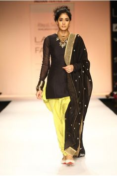 dfba24e7f6 Payal Singhal Indian Wear Collection : : Diva Mul Suit : Black Silk Mul  Fitted Kurti Worn With Kiwi Lime Cotton Silk Jodhpur Pants And Black Silk  Mul ...