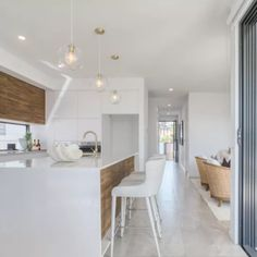 Matt white and timber veneer in this Gold Coast Villa Gold Coast, Villa, Kitchen, Table, Furniture, Home Decor, Kitchens, Cuisine, Interior Design