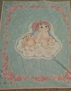 Panel from '89 I came across. Cute little quilt.