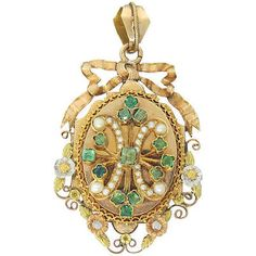 An early Victorian yellow white and rose gold Seed Pearl and Emerald Locket with original crystal on the interior. The locket measures x (excluding the bale). This will fit a chain of up to in width. The locket weighs grams. Victorian Jewelry, Antique Jewelry, Vintage Jewelry, Antique Locket, Vintage Lockets, Simple Necklace Designs, Thin Gold Chain, Gold Locket, Cool Necklaces