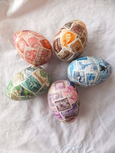 Wooden eggs covered with US stamps. Well, I have a ton of old stamps so I can make this  Also, this site has other ways to cover eggs.