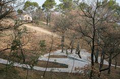 ai weiwei paves château la coste vineyard with a sinuous stone path