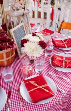 Love the checkered table cloth and idea of hay/straw to wrap napkin