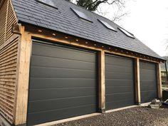 Sectional Garage Door - Centre ribbed panels in a textured anthracite finish Garage Doors Uk, Garage Door Panels, Garage Shed, Garage House, Carport Designs, Garage Design, Garage With Room Above, Timber Frame Garage, Carport Sheds