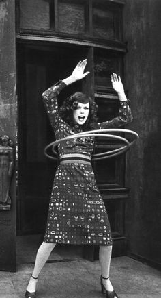 Cropped from original: Paris Vogue, June/July 1971, editorial. Models Wallis Franklin and Louise Despointes hamming it up in hula hoops outside Paris' Palais de Chaillot