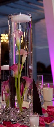 Submerged calla lilies....  another centerpiece option. Submerged callas, wide crystal trim at the bottom of the vase (or crystals in water, as pictured here) with white floating candle