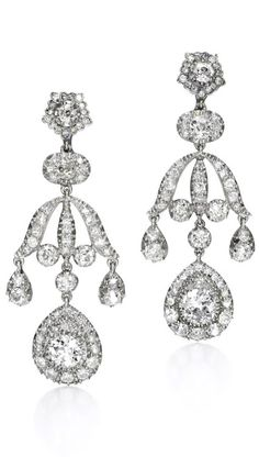 European THE DIAMOND PENDENT EARRINGS each of chandelier design set with circular - and single-cut diamonds, associated case stamped D & J Wellby Ltd. diamonds early 20th century composite Possibly made or altered at the time of acquisition in the first quarter of the 20th century.