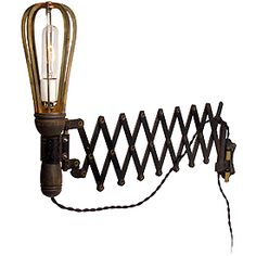 Wall scissor with heavy iron EB caged trouble lamp.
