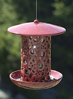 Big hopper/tube bird feeder in rich burgundy or tan with blue glaze. A whimsical and wonderful bird feeder with style and function in mind! Hollow ceramic circle design allows view-thru to birdseed le