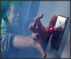 Always push the red button, especially when it's a light switch.