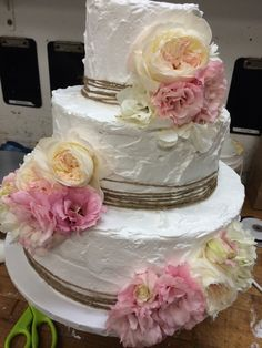 Rustic wedding cake. Twine and garden roses by Great Dane baking company