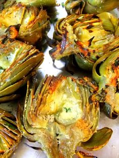 Grilled Artichokes  - Trim and quarter the artichokes and slowly boil them until tender. Let them cool completely down, then pull out the choke and prickly leaves. Place the quartered artichokes in a bowl, drizzle olive oil all over, place grated romano cheese between the leaves along with salt, pepper, finely chopped garlic and fresh parsley. Place them on a hot grill turning them over until the cheese gets crusty and garlic cooks, it just takes a few min...