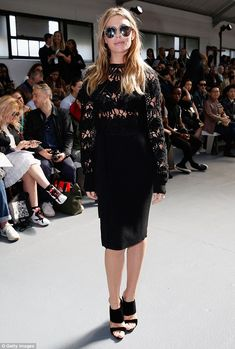 Sophisticated style: Abbey Clancy oozed glamour as she displayed her slim figure in a form-fitting black dress at Sibling's London Fashion Week show on Saturday