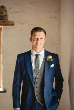 Groom in Blue Wedding Suit with Floral Buttonhole | By Oliver McGivern | Cornwall Wedding | Floral Arch | Summer Wedding | Rustic Wedding | Groom Wedding Suit | Wedding Suit for Groom Blue Suit Wedding, Wedding Suits, Groomsmen Suits, Groom Attire, Rustic Wedding Groom, Morning Suits, Classic Tuxedo, Looking Dapper, Floral Arch