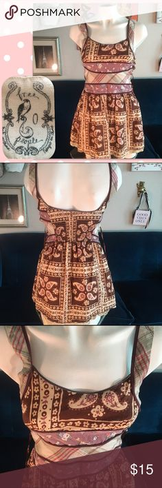 🦋Free People Vintage top🦋 This top has so much great detail and if your small enough you can wear as a dress. Unfortunately it buttons up the side & all but 2 of 11 buttons are missing.(pic 5&6).The fabric is mix matched perfectly and has a underlay slip in cotton n w/lace trim. Elastic panel in back. Front chest is lined. It's very cute and is really made great. (except for the buttons) and excellent condition. So if you sew and are a size zero and love vintage. I found you a new addition…
