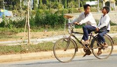 Cambodian local young boys at #battambang is ridding to school. #travel #cambodia #tour #localpeople #school