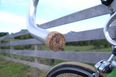 Here's a different adult beverage-related repurposing idea: Use corks as bike handlebar caps.