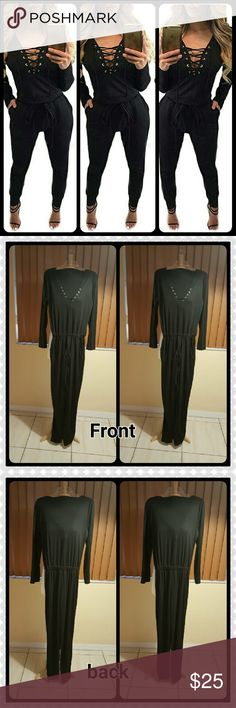 JUST IN. BLACK ONE PIECE JUMPSUIT 100% BNWOT. Good condition. Solid color black. Long sleeves. Deep v neck. .lace up drawstring in front. 65 % cotton and 35% polyester. This is an Asian item which tends to run small. Asian xlarge / us size 12-14. Price firm. No offers. Bundle for discount. unknown  Pants Jumpsuits & Rompers
