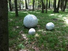 "DIY concrete spheres - make these for your garden using plastic beach balls and wrap in 1/2"" mesh taped to ball.  Then apply concrete and let dry."