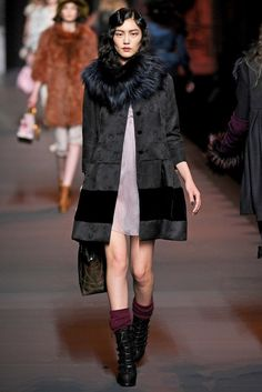 Christian Dior A/W 2011/2012, This coat fits cohesively with Dior's 2011/2012 collection , basic colors and designs with fur to make it edgier