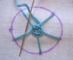The spider web filling stitch  is another stitch from my 1964 Coats & Clarks booklet One Hundred Embroidery Stitches . It's also shown in an...