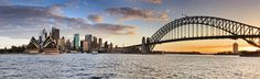 Sydney Kiribilli CBD sunset panorama - Sydney Australia NSW city landmarks at sunset time when orange sun sets behind harbour bridge in wide panoramic view