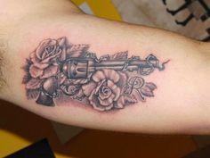 Gun & rose tattoo for women