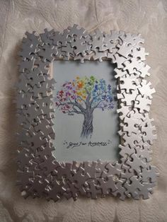 Autism Awareness handmade photo frame with by AutismeAwarenessShop-- easy DIY! Puzzle pieces frame from the dollar tree glue and some spray paint all done :) maybe some sparkles! Puzzle Piece Crafts, Puzzle Art, Frame Crafts, Diy Frame, Puzzle Pieces, Puzzle Frame, Puzzle Picture Frame, Crafts To Make, Craft Projects