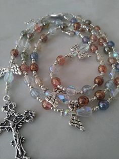 The Crucifix Measures 5//8 x 1//4 Pius X Medal The Charm Features a St Silver Plate Rosary Bracelet Features 6mm Pink Fire Polished Beads Patron Saint First Communicants