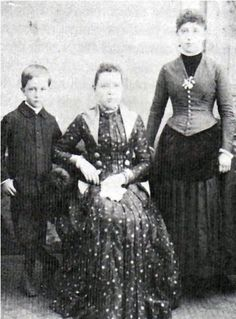 Sitting is Laura Ann Wilder Howard and son, Harrison and her daughter, Angelina.