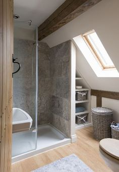 Shower room oak beams and change the stone clad wall for glass