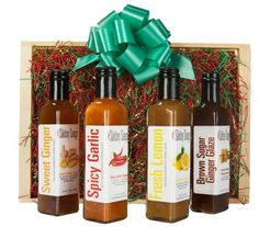 The Saucey Sauce Company Gift Box, containing 4 of their signature sauces in a festive wooden crate } Order now at ManyKitchens.com