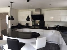This sweeping curved peninsular is a great feature in this monochrome kitchen.