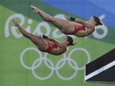 Canada's Meaghan Benfeito (left) and Roseline Filion perform in the women's synchronized platform diving final at the 2016 Summer Olympics in Rio de Janeiro, Brazil, Tuesday, Aug. 2016 THE CANADIAN PRESS/Frank Gunn Brazil Olympics 2016, Summer Olympics, Olympic Sports, Olympic Games, Rio Games, Diving Springboard, Swimming Diving, Rio De Janeiro, Sports
