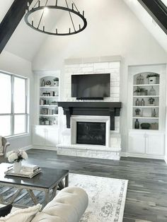 "You could never get tired of a fireplace with white stone! The stone here is ""Chopped Blanco Austin Stone"".  Trim and cabinets paint color: SW Pure White."