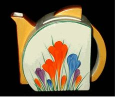 CROCUS STAMFORD Teapot by Clarice Cliff in the Crocus pattern and Stamford shape. Has the early Angular spout.  Paintwork is excellent. Size 4.5 inches tall.  Signed Bizarre by Clarice Cliff.