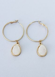 """Midi hoops accented with sparkling druzy drops set in a gilded rim. Matte gold finish. Synthetic druzy. Hoop measures 3/4"""" in diameter, 1 1/2"""" long, snap back closure. $28.00"""