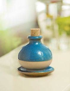 Monet Diffuser by Gardener's Supply. $9.95. Back by customer demand! This rustic, glazed-clay diffuser disperses calming, natural scents at home or at the office. Simply pour a few drops of your choice of fragrant essential oil in the top, close with cork, and the scent will be slowly released through the unglazed underside.