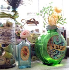 Crafts:  #Crafts ~ Decorate glass bottles with vintage labels and Mod Podge.