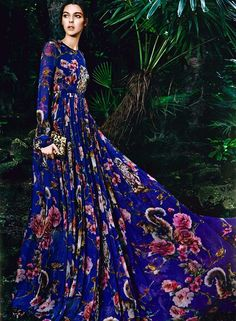 Show off some serious flower power in this stunning Dolce & Gabbana F/W 2014 long sleeve empire dress. For more fall fashion, visit http://balharbourshops.com/