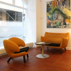 Danish design classics - Pelican Chair and Poet Sofa designed by Finn Juh and Train coffee table designed by Henrik Tengler and produced by Onecollection.