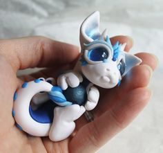 White and Blue Bitty Baby Dragon with a ball by BittyBiteyOnes.deviantart.com on @deviantART