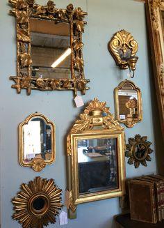 Gilded mirrors at MAI Houston