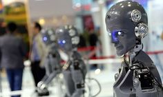 A line of human-shaped robots on display at an industry fair. These will be replacing working men and women all over the world...is that what we want?