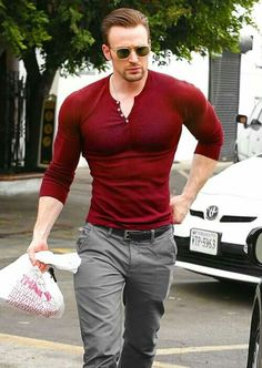 Chris Evans. Is this photoshopped? Because holy cow, his shoulder to waist ratio is out of this world.